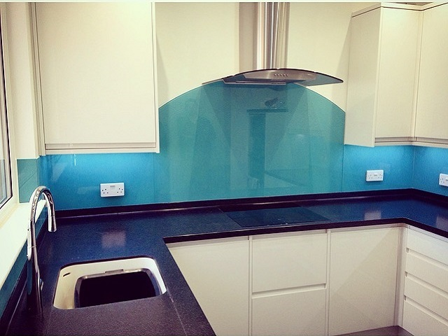 Add a vibrant touch of colour to you kitchen with a glass splashback.