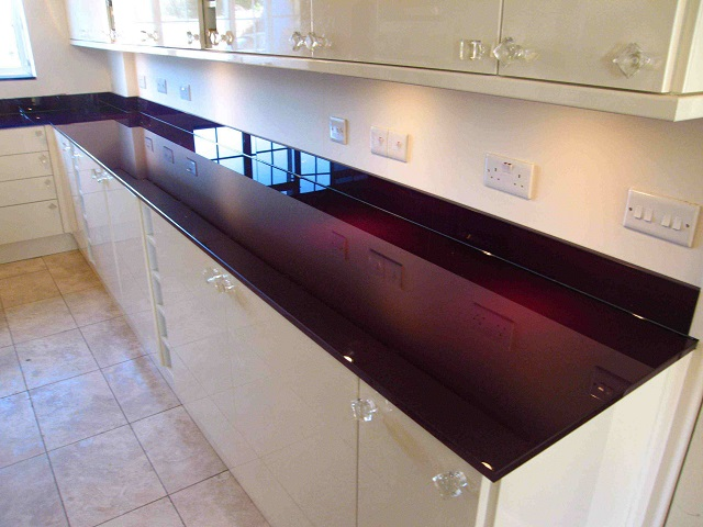 Coloured glass worktops installed by Apex Glass and Glazing Aberdeen.